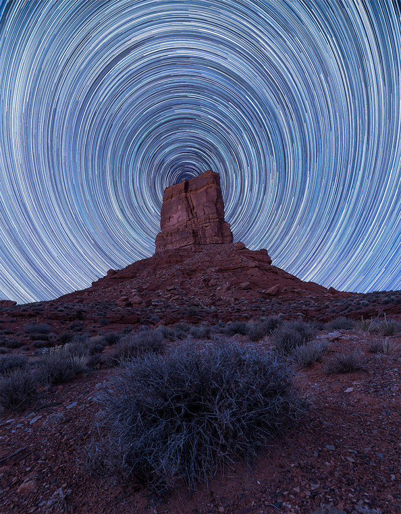 Celestial Dance above a Silent Tower in the Desert, Utah, image by Peter Nestler