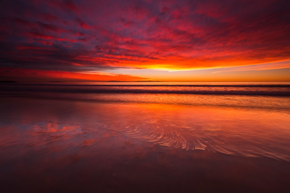 Sunset over the Channel Islands, Ventura State Beach, image by Russ Bishop