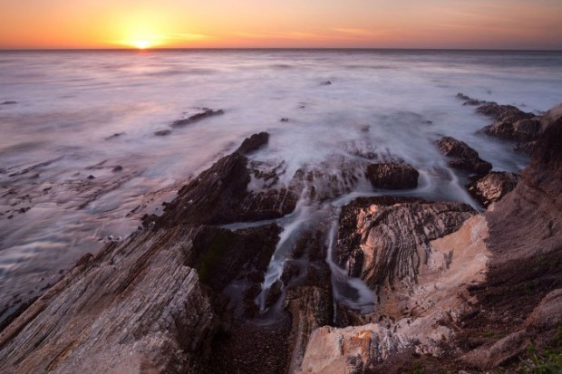 Morro Bay sunset: Canon 5D mark II, F/16, 13 seconds, ISO 100. I used a 5-stop neutral density filter to obtain the softness of the waves. © Jennifer Wu