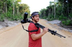 Andrew Snyder in the field with camera equipment