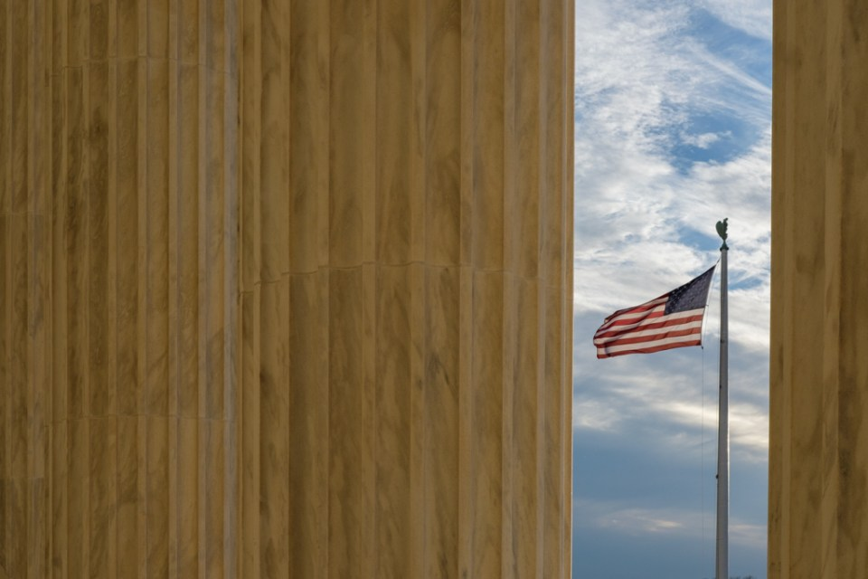 Columns and U.S. Flag at U.S. Supreme Court, Washington D.C. USA.