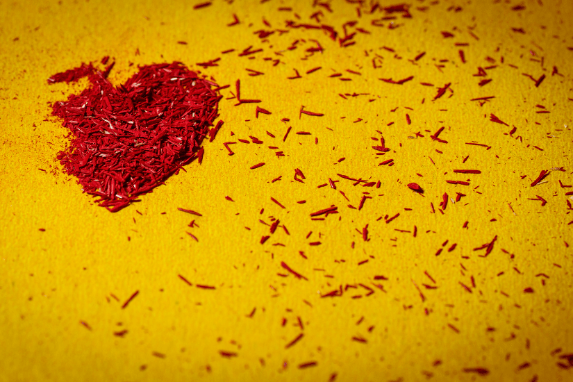 heart that is broken on a yellow background