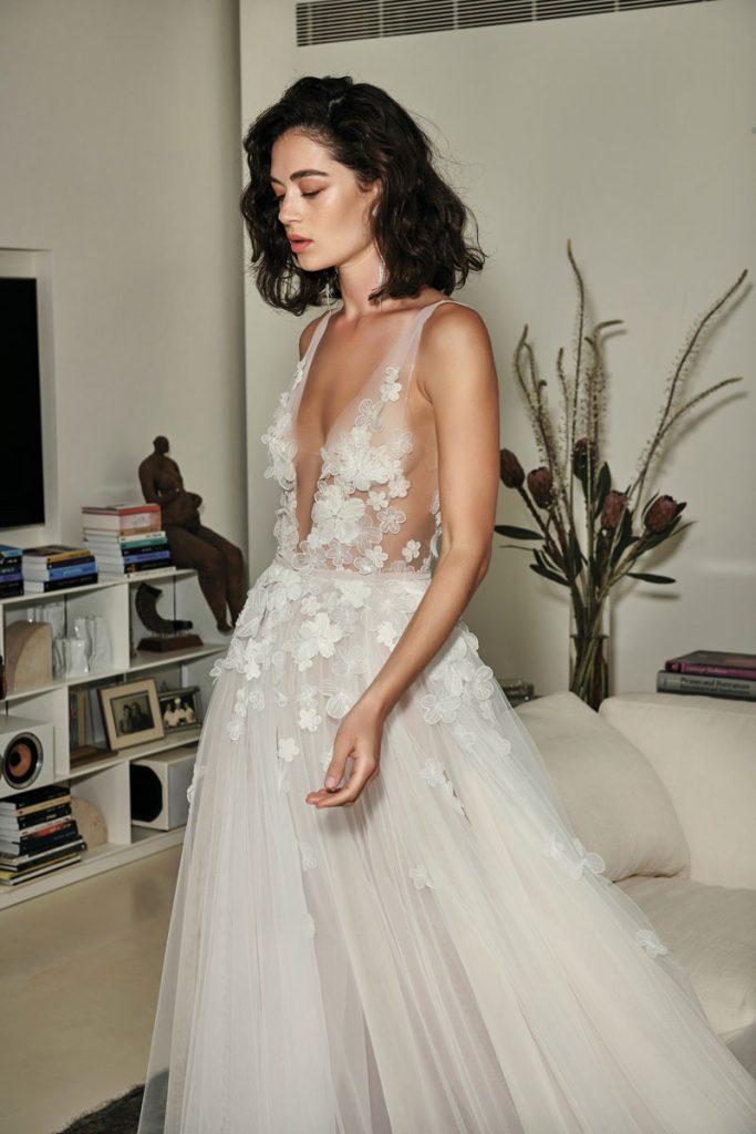 Ari silk tulle dress with cascading 3D flowers ($ 9,790), Mira Zwillinger, Boca Raton Bridal