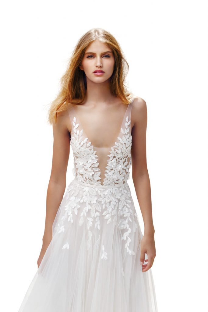 Elli silk tulle dress with a deep V-neckline in ivory adorned with scattered sparkling leaf appliqués and floral accents ($ 9,790), Mira Zwillinger