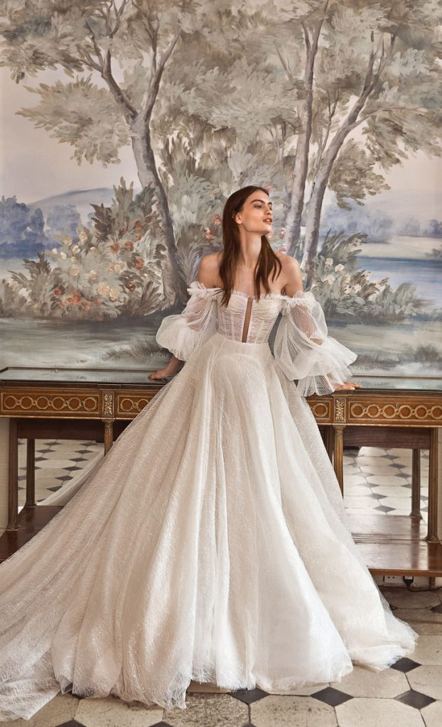 Seraphina ball gown in sparkling tulle with pleated lantern sleeves and a see-through corset ($ 7,440), Galia Lahav, Miami