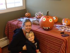 LD and mom decorate a pumpkin