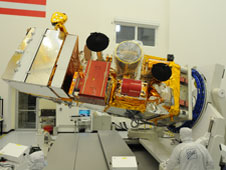 NASA's NPP weather satellite shown in a Ball Aerospace clean room.