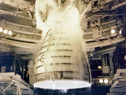 Space shuttle main engine undergoes a test firing.