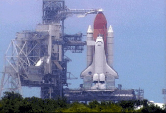 Space Shuttle Discovery at launch pad.