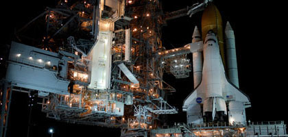 Space shuttle Atlantis at launch pad 39A.