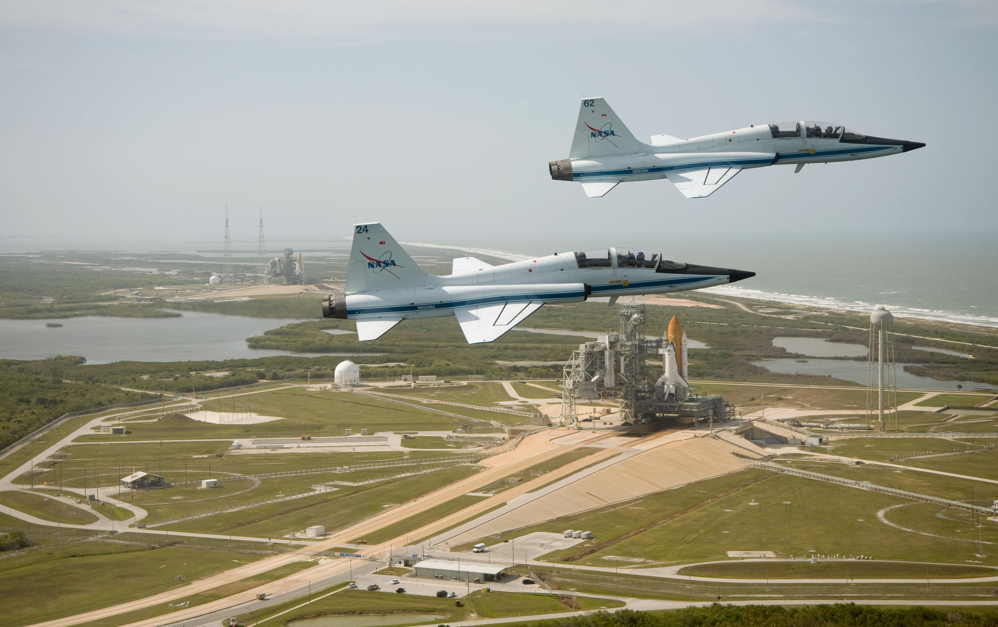 Two T 38 Jet Trainer Aircraft Fly Over Kennedy Space