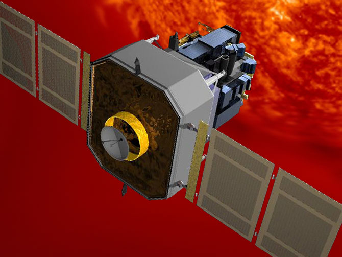 Artist's concept of SOHO spacecraft observing the sun.