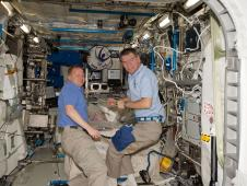 STS-133 pilot Eric Boe and European Space Agency astronaut Paolo Nespoli, Expedition 26 flight engineer.