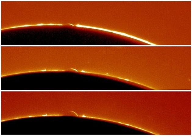 Three photos of the arc of Venus observed during the planet's 2004 transit by amateur astronomer André Rondi near Toulouse, France.