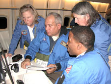 Airborne Astronomy Ambassadors Constance Gartner, Vince Washington, Ira Hardin and Chelen Johnson at the educators' work station aboard the SOFIA observatory during a flight on the night of Feb. 12-13, 2013.