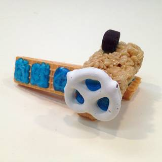 Edible spacecraft made of cookies and a pretzel