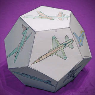 A 3-D dodecahedron made of paper featuring images of aircraft