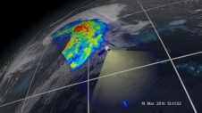 satellite flys over earth, recording a swath of colorized data over a cyclone