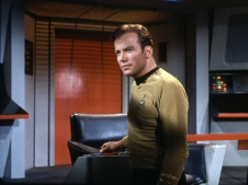 "William Shatner as Captain James Tiberius Kirk, commander of the starship USS Enterprise in NBC's science fiction television series ""Star Trek."""