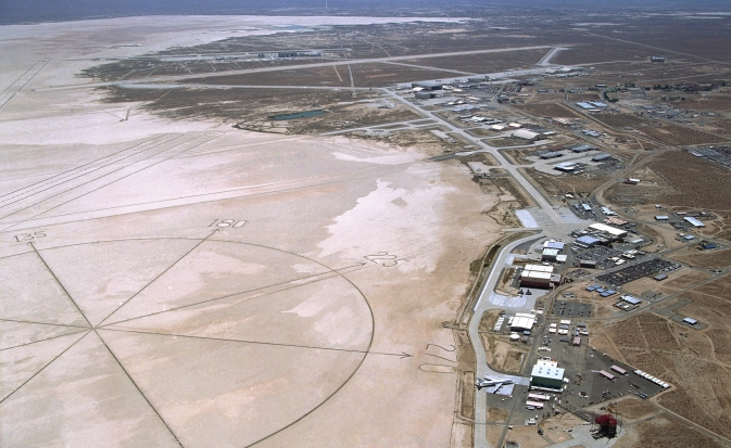 As of March 1, 2014, NASA's Dryden Flight Research Center along the northwest edge of Rogers Dry Lake at Edwards Air Force Base, Calif. is renamed in honor of former research test pilot and NASA astronaut Neil A. Armstrong, the first man to step onto the surface of the moon during the Apollo 11 mission in 1969.