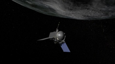 This is an artist's concept of NASA's OSIRIS-REx spacecraft preparing to take a sample from asteroid Bennu.