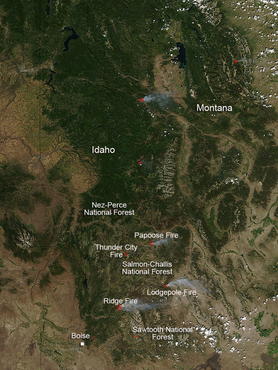 Photo of Idaho from about July 20, 2013, showing then-active fires in the state -- north at top of photo. Notice Craters of the Moon National Monument, the dark area in the southeast section -- this area is obscured by new fires in the photos above.