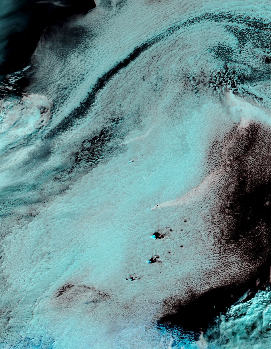 The Moderate Resolution Imaging Spectroradiometer (MODIS) aboard NASA's Aqua satellite flew over the South Sandwich Islands on April 19, 2014 and acquired this false-color image of the cloudy scene.