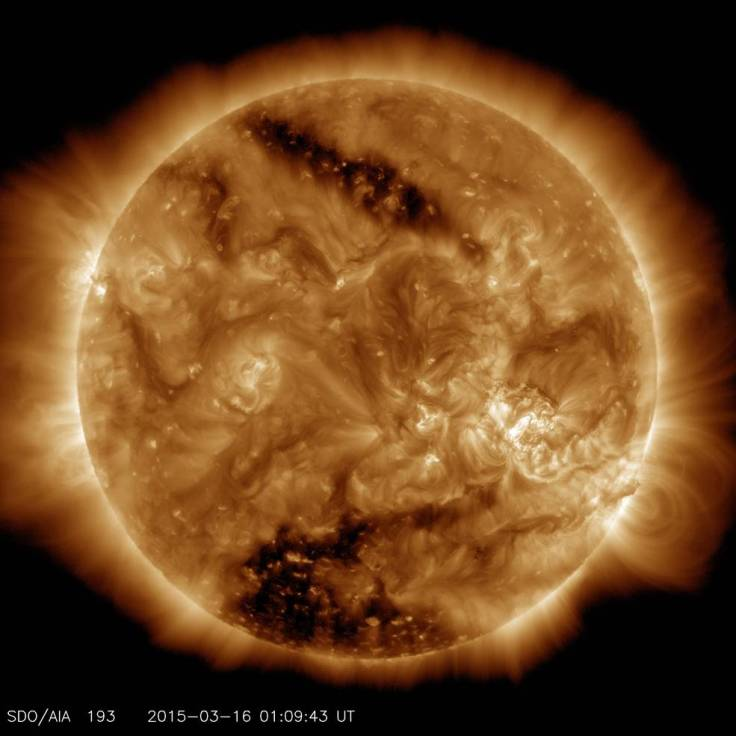 Two coronal hole, the two dark areas, on the sun as seen by SDO.