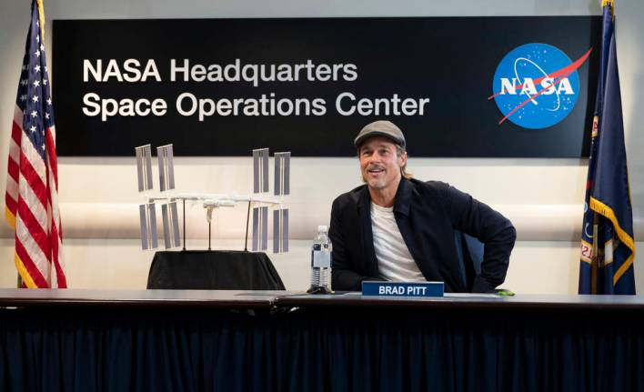Actor Brad Pitt talks to NASA astronaut Nick Hague