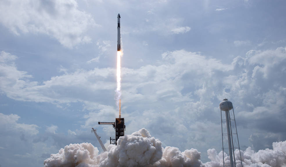 A SpaceX Falcon 9 rocket carrying the company's Crew Dragon spacecraft is launched from Launch Complex 39A