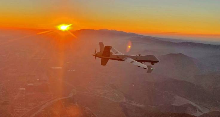 An MQ-9 remotely piloted aircraft views the smoky San Gabriel Mountains of southern California.