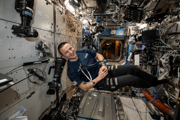 astronaut andrew morgan floating inside the space station