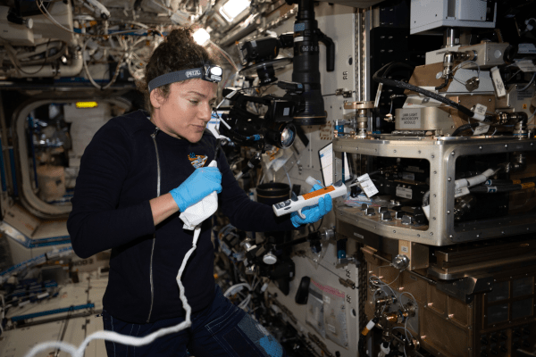 NASA astronaut Jessica Meir configures the Light Microscopy Module