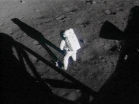 apollo_11_armstrong_collecting_contingency_sample_from_16_mm