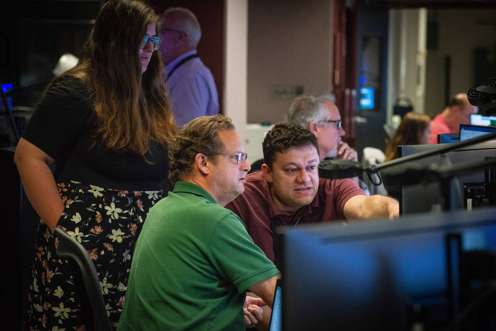 Members of the Hubble operations team work in the control room July 15 to restore Hubble to science operations.