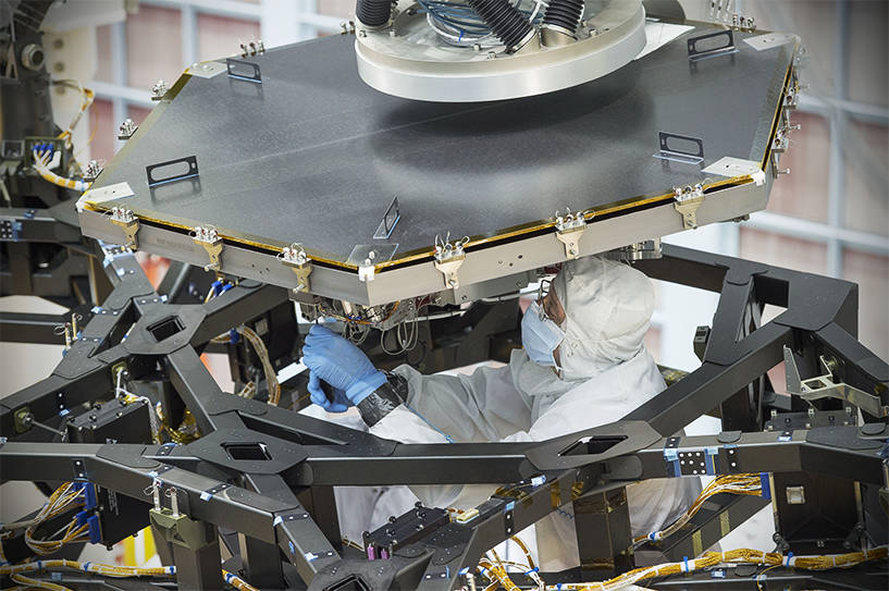 An engineer at NASA's Goddard Space Flight Center worked to install the first flight mirror onto the telescope structure at NASA's Goddard Space Flight Center in Greenbelt, Maryland.