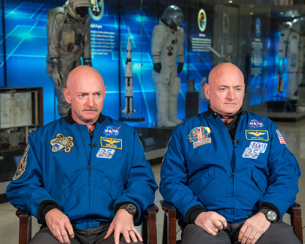 JSC2015E004192 (01/19/2015) ---In Houston Texas at the Johnson Space Center Expedition 45/46 Commander, Astronaut Scott Kelly along with his brother, former Astronaut Mark Kelly speak to news media on Jan. 19, 2015 about Scott Kelly's 1-year mission aboard the International Space Station. Photographer: Robert Markowitz