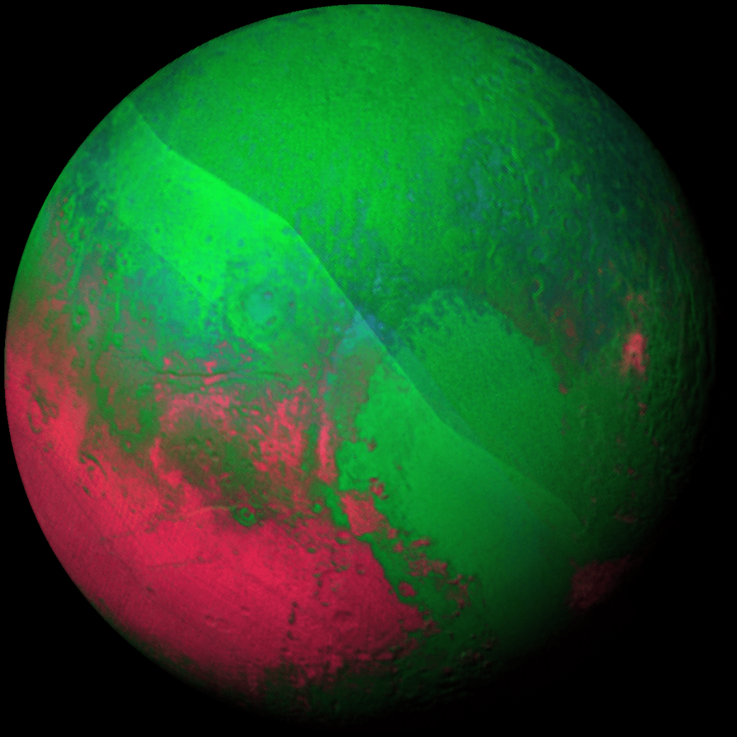 Pluto gets into the holiday spirit, decked out in red and green using a pair of Ralph/LEISA instrument scans