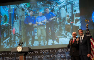 Vice President Mike Pence and NASA Administrator Jim Bridenstine talk with astronauts onboard the International Space Station