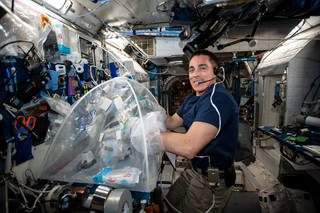 astronaut Chris Cassidy working on the Food Physiology experiment