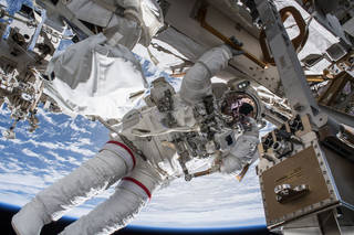astronaut working on ISS