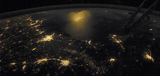 """""""Earth at Night"""" shows how scientists use images such as this astronaut photo of the Gulf of Mexico taken from the ISS"""