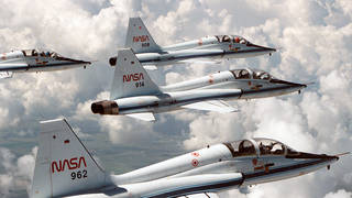 Several NASA T-38 astronaut training jets fly in formation.