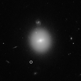 black-and-white image from Hubble showing location of black hole