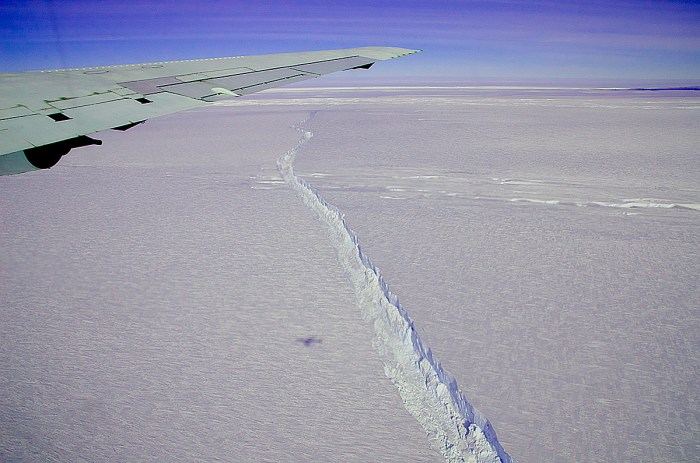 A photo from the window of NASA's DC-8 shows the rift across the Pine Island Glacier ice shelf running off toward the horizon.