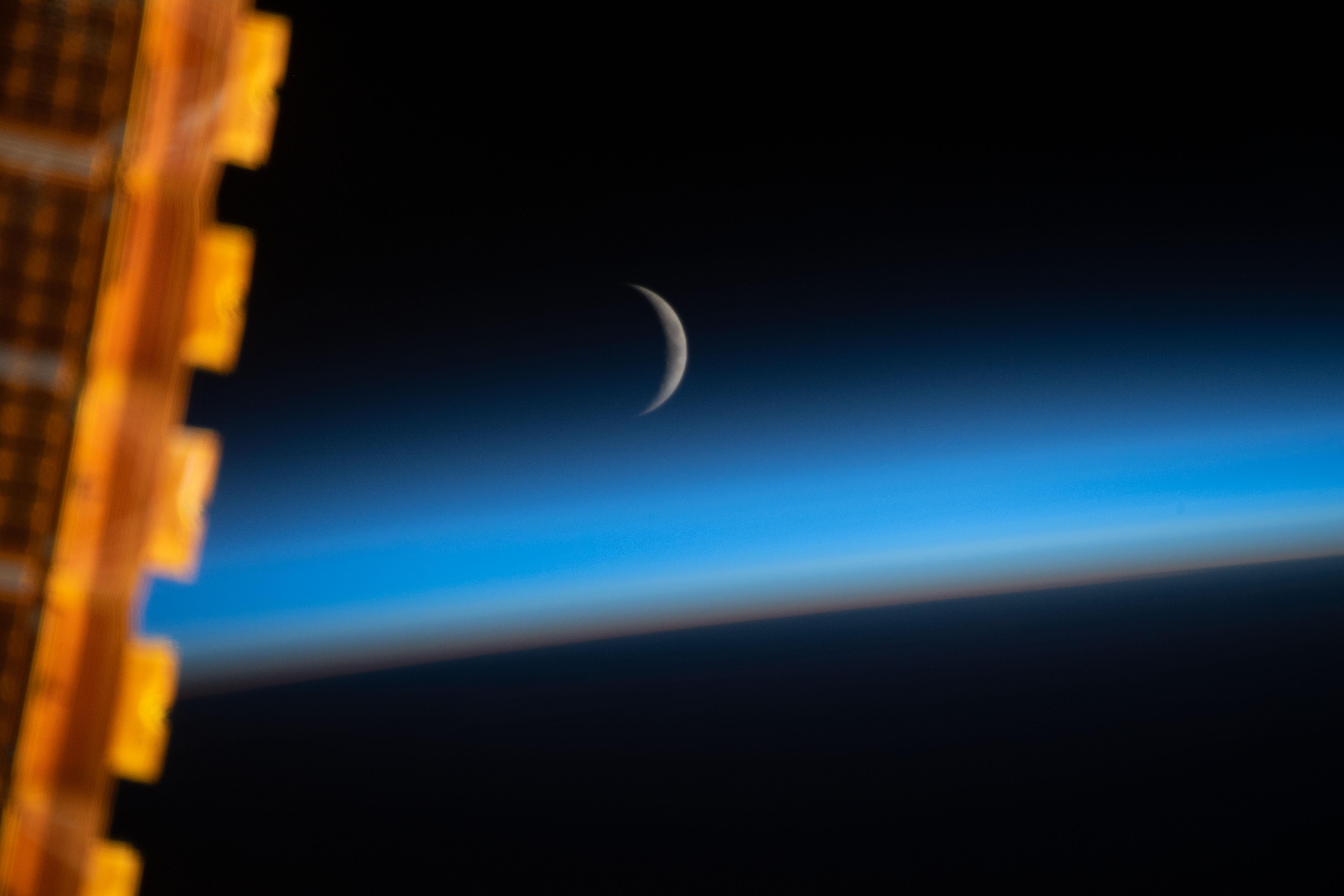waxing crescent moon above