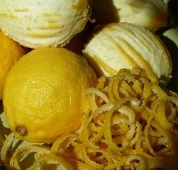 Four partially peeled lemons