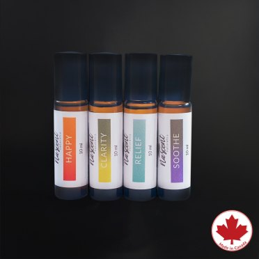 A group photo of Nascent Naturals rollerballs in front of a black background