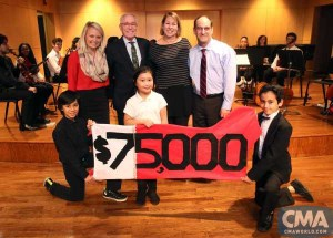 The CMA Foundation announces a $75,000 grant to W.O. Smith School in Nashville Tuesday night at the school's winter recital. (front, l-r) W.O. Smith students Jean Carlo Arias Neda, age 10; Whitney Thai, age 8; and Gabriel Barreda, age 11. (back, l-r) Tiffany Kerns, CMA Community Outreach Manager; Ron Samuels, CMA Foundation Board Chairman; Sarah Trahern, CMA Chief Executive Officer; Jonah Rabinowitz, W.O. Smith School Executive Director. Photo Credit: Kayla Schoen / CMA