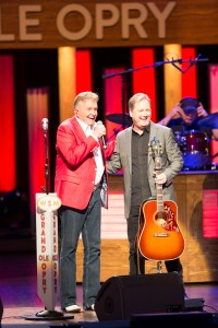 Bill Anderson (l) joins Steve Wariner on the stage of the Grand Ole Opry.